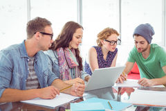 Fashion students working as a team Stock Photo