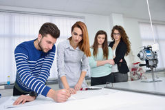 Fashion students working as a team at the college Stock Image