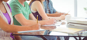 Fashion students writing on notepad Royalty Free Stock Images