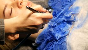 Fashion studio, the model is preparing for the show. Teen girl lies on a special couch, designer prepares her image. Fashion studio, the model is preparing for stock video