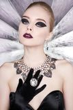 Woman with bright makeup and with set jewelry Royalty Free Stock Images