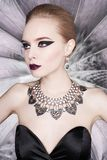 Woman with bright makeup and with set jewelry Stock Images