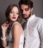 Fashion studio photo of beautiful sexy couple Stock Photos