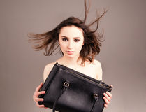 Fashion studio photo of elegant nude woman with bag Royalty Free Stock Photos