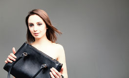 Fashion studio photo of elegant nude woman with bag Royalty Free Stock Image