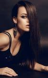 Fashion studio photo of sensual woman with dark hair wearing elegant dress and bijou. Fashion studio photo of beautiful sensual woman with dark hair wearing Stock Photos