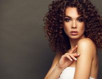 Fashion studio portrait of beautiful smiling woman with afro curls hairstyle. Fashion and beauty. Fashion studio portrait of beautiful smiling woman with afro stock photo