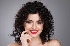 Smiling woman with curls hairstyle royalty free stock photography