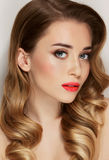 Fashion studio portrait of beautiful young woman with elegant hairstyle Stock Photo