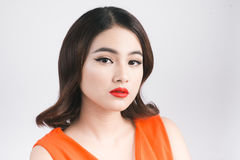 Fashion studio portrait of gorgeous sensual asian woman with dar. K hair wears elegant red dress stock photos