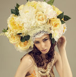 Fashion studio portrait of woman with flowers. Fashion studio portrait of woman wearing roses and flowers in headdress in studio royalty free stock photos