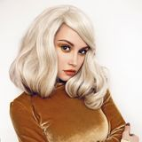Beautiful blonde in velvet dress. Fashion studio portrait of young beautiful blonde in brown velvet dress Stock Image