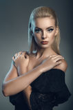 Fashion studio portrait of young beautiful woman on dark background Royalty Free Stock Photos