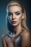 Fashion studio portrait of young beautiful woman on dark background Stock Photography