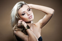 Fashion studio portrait of young woman Royalty Free Stock Photography