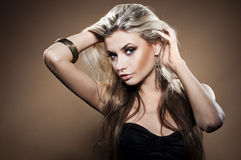 Fashion studio portrait of young woman Stock Photography