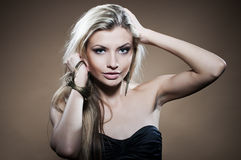 Fashion studio portrait of young woman Royalty Free Stock Image