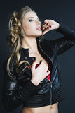 Fashion portrait of young woman in leather jacket Royalty Free Stock Photography