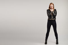 Fashion studio shot of attractive model. In leather jacket and jeans Royalty Free Stock Image