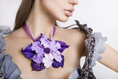 Fashion studio shot of beautiful woman with a big floral necklac Royalty Free Stock Photography