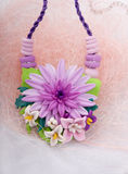 Fashion studio shot of a floral necklace (jewelery made of polym Stock Photography