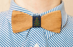 Fashion style. Bearded man in a shirt with a wooden bow tie royalty free stock photos