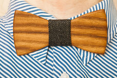 Fashion style. Bearded man in a shirt with a wooden bow tie stock images