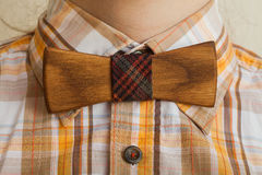 Fashion style. Bearded man in a shirt with a wooden bow tie royalty free stock photography