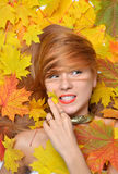 Fashion style happy fall woman lying autumn forest leaves Stock Images