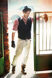 Fashion style man in the old wicket gate Royalty Free Stock Images