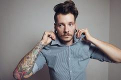 Fashion style photo of tattooed hipster man Royalty Free Stock Photo