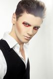 Fashion style photo of a young man with makeup Stock Photo