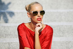 Fashion style portrait of attractive young woman in sunglasses Royalty Free Stock Image