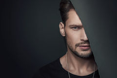 Fashion style portrait of a muscular guy Stock Photos