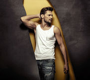 Fashion style portrait of a muscular, handsome man Royalty Free Stock Photography