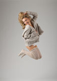 Fashion style portrait of young jumping girl Stock Images