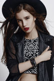 Fashion style portrait of young pretty stylish girl stock photo