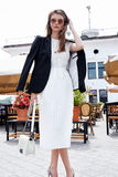 Fashion style street look elegant brunette woman walk cafe resta Royalty Free Stock Photography