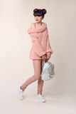 Fashion style teen look. Fashionable young girl wears in wool sw Stock Images