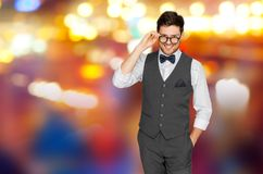 Man in suit with glasses over night city lights. Fashion, style and vintage concept - happy man in festive suit and eyeglasses over night city lights background Royalty Free Stock Photography