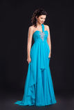 Fashion style. Woman in classic cyan dress posing Royalty Free Stock Photo