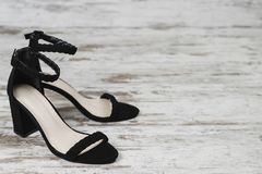 Fashion style women`s black shoes black heels copy space royalty free stock photo