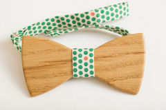 Fashion style. Wooden bow tie handmade accessories on a white background royalty free stock images