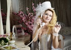 Fashion stylish beauty bride portrait speaks by vintage phone Stock Photos