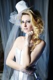 Fashion stylish beauty bride portrait with white long curly hair and hat Stock Image