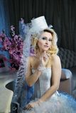 Fashion stylish beauty bride portrait with white long curly hair and hat Royalty Free Stock Photos