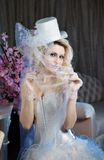 Fashion stylish beauty bride portrait with white long curly hair and hat Royalty Free Stock Photo