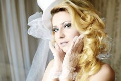 Fashion stylish beauty bride portrait with white long curly hair and hat Stock Photography