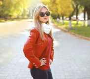 Fashion stylish pretty woman in jacket and sunglasses. And outdoors royalty free stock photography