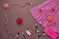 Fashion Stylish Set. Top view. Essentials Cosmetic. Fashion woman Clothes Accessories Set. Fashion Cosmetic Makeup. Stylish Dress Glamor fashion Handbag Clutch Royalty Free Stock Photos